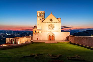 Facade of Basilica di San Francesco d'Assisi, UNESCO World Heritage Site, and gardens at dusk, Assisi, Perugia province, Umbria, Italy, Europe