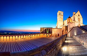 Panoramic of the illuminated arcade and Basilica di San Francesco during blue hour, UNESCO World Heritage Site, Assisi, Perugia province, Umbria, Italy, Europe