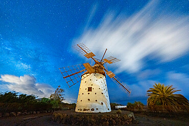 Milky Way glowing over the stone windmill, El Cotillo, La Oliva, Fuerteventura, Canary Islands, Spain, Atlantic, Europe