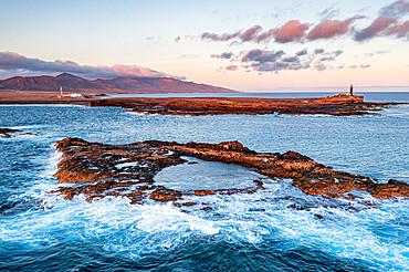 Crashing waves in the rough sea at Punta Jandia lighthouse (Faro de la Lola), Fuerteventura, Canary Islands, Spain, Atlantic, Europe