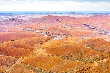 Winding road in the desert landscape from Mirador del Risco de las Penas viewpoint, Pajara, Fuerteventura, Canary Islands, Spain, Atlantic, Europe