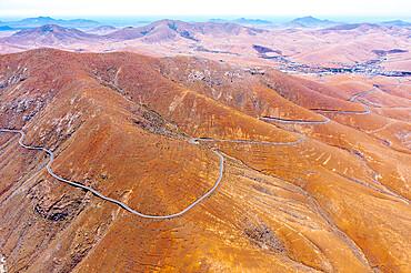 Aerial view of empty desert road, Mirador del Risco de las Penas viewpoint, Pajara, Fuerteventura, Canary Islands, Spain, Atlantic, Europe
