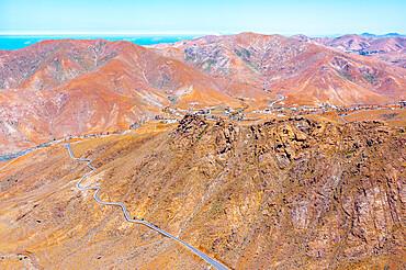 Aerial view of desert road in the barren landscape, Mirador del Risco de las Penas, Pajara, Fuerteventura, Canary Islands, Spain, Atlantic, Europe