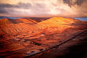 Aerial view of sunrise over the dry desert land of Caldereta, Vallebron, La Oliva, Fuerteventura, Canary Islands, Spain, Atlantic, Europe