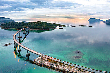 Aerial view of car traveling on Sommaroy bridge at sunset, Sommaroy, Troms county, Northern Norway