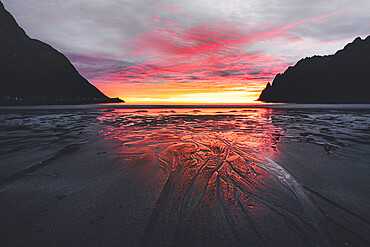 Empty Ersfjord beach against the cloudy sky and midnight sun, Senja island, Troms county, Norway