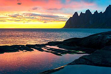 Sharp mountain peaks under the dramatic sky of midnight sun, Tungeneset viewpoint, Senja island, Troms county, Norway