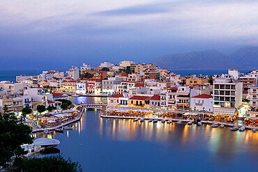 Agios Nikolaos old town with lake in its centre at dusk, Lasithi prefecture, Crete, Greece