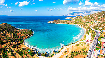 Aerial view of Almyros Beach washed by the turquoise sea in the gulf of Mirabella, Agios Nikolaos, Crete island, Greece
