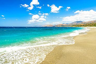 Waves of turquoise clear sea crashing on white sand of Triopetra beach, Plakias, Crete island, Greece