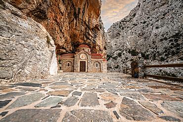 Orthodox chapel Agios Nikolaos nestled in rocks in Kotsifou canyon, Crete island, Greek Islands, Greece, Europe