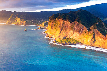 Aerial view of majestic cliffs and coastline at sunrise from Guindaste viewpoint, Faial, Madeira island, Portugal