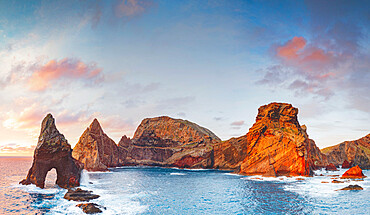Natural arch stone rocks and cliffs at dawn from Ponta do Rosto viewpoint, Sao Lourenco Peninsula, Madeira island, Portugal