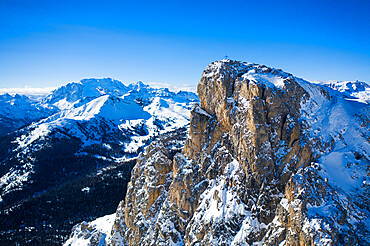 Aerial view of Sass de Stria mountain peak with Marmolada covered with snow on background, Dolomites, Veneto, Italy