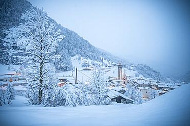 Alpine village in the white winter landscape after the snowfall, Gerola Alta, Valgerola, Valtellina, Lombardy, Italy