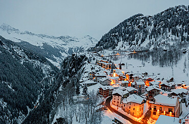 Small village of Pianazzo on top of snowcapped mountain after a snowfall, Madesimo, Valle Spluga, Valtellina, Lombardy, Italy