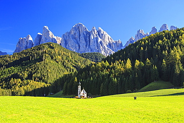 Church of Ranui surrounded by green meadows in autumn, St. Magdalena, Funes Valley, South Tyrol, Dolomites, Italy, Europe