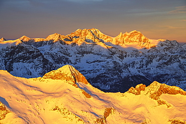 Aerial view of peak Baroni and Bernina Group at sunset, Masino Valley, Valtellina, Lombardy, Italy, Europe