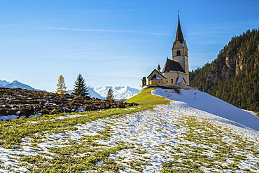 The church of the little village of Schmitten surrounded by snow, Albula District, Canton of Graubunden, Switzerland, Europe