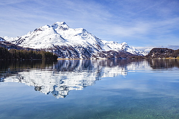 Piz da la Margna is reflected in the clear water of Lake Sils, Maloja Pass, Engadine, Canton of Graubunden, Switzerland, Europe