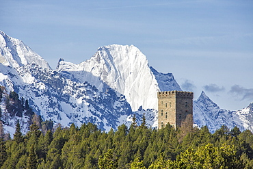 The Belvedere Tower frames the snowy peaks and Peak Badile on a spring day, Maloja Pass, Canton of Graubunden, Switzerland, Europe