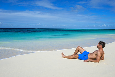 Man relaxing on the world class Shoal Bay East beach, Anguilla, British Oversea territory, West Indies, Caribbean, Central America