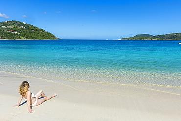 Woman relaxing on Long Bay Beach, Beef Island, Tortola, British Virgin Islands, West Indies, Caribbean, Central America