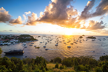 Sunset over the luxury yachts, in the harbour of Gustavia, St. Barth (Saint Barthelemy), Lesser Antilles, West Indies, Caribbean, Central America