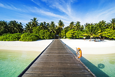Long pier leading to a small island over turquoise water, Sun Island Resort, Nalaguraidhoo island, Ari atoll, Maldives, Indian Ocean, Asia