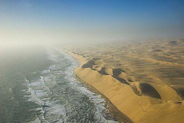 Aerials of sand dunes of the Namib Desert meeting the Atlantic Ocean, Namibia, Africa