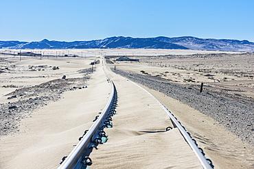 Railway tracks overflown by sand, old diamond ghost town, Kolmanskop, near Luderitz, Namibia, Africa