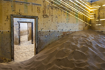 Sand in an old colonial house, old diamond ghost town,  Kolmanskop (Coleman's Hill), near Luderitz, Namibia, Africa
