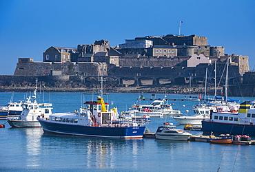 Fishing boats below Cornet castle, Saint Peter Port, Guernsey, Channel Islands, United Kingdom, Europe