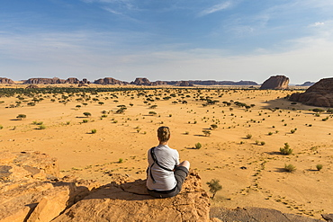 Woman enjoying the beautiful scenery, Ennedi Plateau, UNESCO World Heritage Site, Ennedi region, Chad, Africa