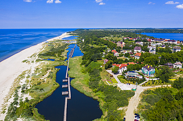 Aerial by drone of a boardwalk in a little lake on the coast of Yantarny, Kaliningrad, Russia, Europe