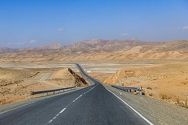 Long straight road between Bamyan and Yakawlang, Bamyan, Afghanistan, Asia