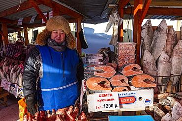 Yakutian saleswoman, Fish and meat market, Yakutsk, Sakha Republic (Yakutia), Russia, Eurasia