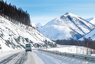 Minivan driving on the Road of Bones, Suntar-Khayata Range, Sakha Republic (Yakutia), Russia, Eurasia
