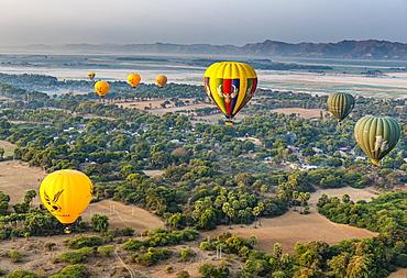 Hot air balloons at sunrise over temples of Bagan (Pagan), Myanmar (Burma), Asia