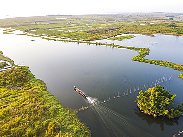 View by drone of little boat on Inle Lake between the floating gardens, Shan state, Myanmar (Burma), Asia