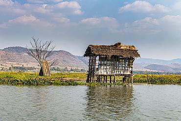 Hut on stilts, Tharkong Pagoda, southern Inle Lake, Shan state, Myanmar (Burma), Asia