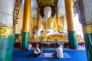 Pilgrims praying in the Shwedagon pagoda, Yangon (Rangoon), Myanmar (Burma), Asia