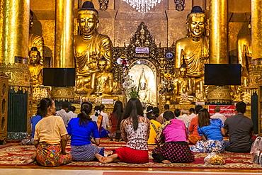 Pilgrims in the Shwedagon pagoda, Yangon (Rangoon), Myanmar (Burma), Asia