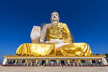 Giant sitting Buddha below the Kyaiktiyo Pagoda (Golden Rock), Mon state, Myanmar (Burma), Asia