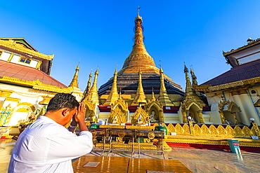 Man praying in the Kyaikthanian paya, Mawlamyine, Mon state, Myanmar (Burma), Asia