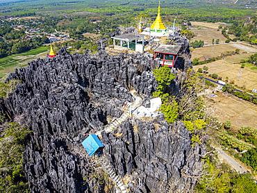 Aerial by drone of Kyauktalon Taung crag with a Hindu temple, near Mawlamyine, Mon state, Myanmar (Burma), Asia