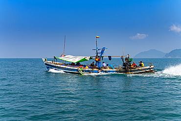 Sea gypsies Moken on their fishing boat, Mergui (Myeik) Archipelago, Myanmar (Burma), Asia