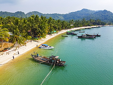 Aerial by drone of a Moken, sea gypsy village on a white sand beach, Mergui (Myeik) Archipelago, Myanmar (Burma), Asia