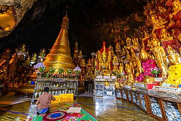 Pilgrims at the gilded Buddha images in the caves at Pindaya, Shan state, Myanmar (Burma), Asia