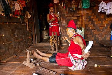 Old Kayan women weaving the traditional way, Kayah village, Loikaw area, Kayah state, Myanmar (Burma), Asia